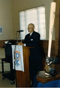 Byron speaking at the lecture series